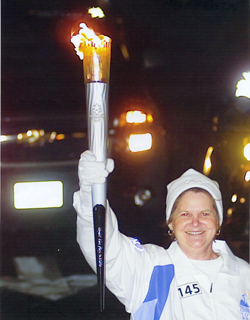 Susan Gregg-Schroeder Carrying the Olympic Torch